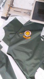 Potongan bahan jas hujan satpol pp Purwakrta setelah disablon