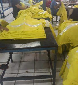 proses produksi jas hujan press bahan pvc berkualitas minimal 100pcs